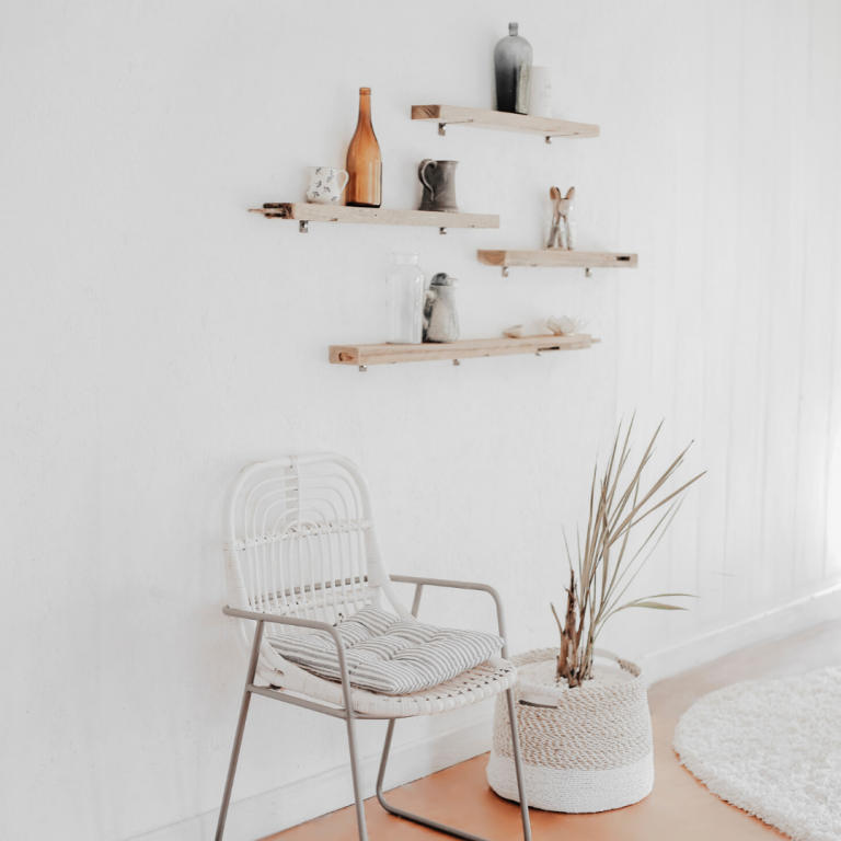 spacious modern interior with a chair and shelf on the wall